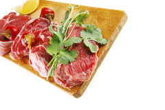 Raw meat chunk on wood Royalty Free Stock Photos