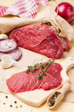 Raw meat for cooking with thyme and spices. Fresh raw meat for cooking with thyme, onion and spices Stock Photo