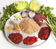 Raw meat, with cracked wheat and other ingredients for Turkish s. Tyle meatball Royalty Free Stock Photos