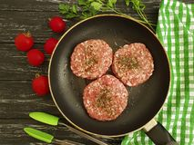 Raw meat, cutlet, minced tomato traditional meat on a wooden background. Raw meat, cutlet, minced meat on a wooden background towel traditional tomato royalty free stock photo