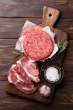 Raw meat and cutlet Stock Photography