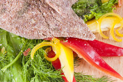 Raw meat cutlet with vegetables. Fresh raw meat cutlet with vegetables and herbs Stock Photography