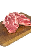 Raw meat on cutting board Royalty Free Stock Images