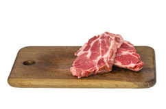 Raw meat on cutting board Stock Images