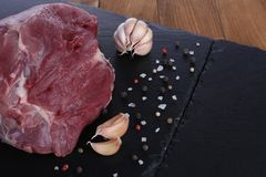 Raw meat on cutting board with spices. Closeup Royalty Free Stock Images