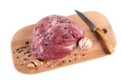 Raw meat on cutting board with spices. Isolated on white Royalty Free Stock Photography