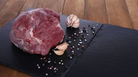 Raw meat on cutting board with spices. Closeup Royalty Free Stock Photos