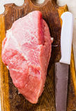 Raw meat on a cutting board. On a white background Stock Images