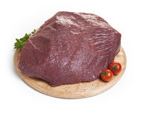 Raw meat on a cutting board. On a white background Stock Image