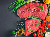 Raw meat on dark background Royalty Free Stock Photo