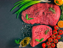 Raw meat on dark background Royalty Free Stock Photos