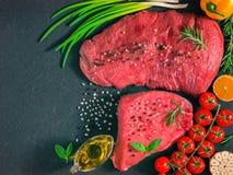 Raw meat on dark background Stock Photos