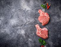 Raw meat on dark background. Top view Royalty Free Stock Image