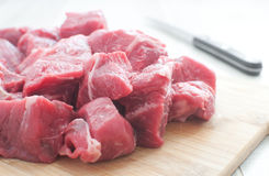 Raw meat diced for stew. Horizontal royalty free stock image