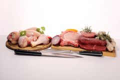 Raw meat. Different types of raw pork meat, chicken and beef with spices and herbs. And sausages royalty free stock photo