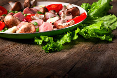 Raw meat in dish and frying pan, spices, knife on wooden table,. Vegetables, top view Stock Photos