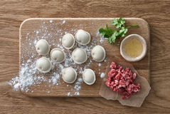Raw meat dumplings cooking Stock Photo