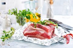 Raw meat in foil. Raw meat with aroma spice and salt, stock photo Royalty Free Stock Photo