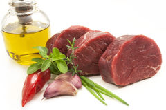 Raw meat. Fresh herbs, garlic, red pepper and olive oil Stock Photo