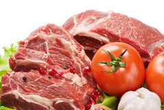 Raw meat and fresh vegetables Royalty Free Stock Images