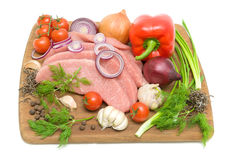 Raw meat and fresh vegetables isolated on white background Stock Photos
