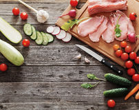 Raw meat with fresh vegetables Stock Photography