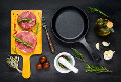 Raw Meat with Frying Pan and Cooking Ingredients Stock Image