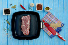 Raw meat in a frying pan and spices. For the grill Royalty Free Stock Image