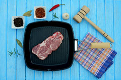 Raw meat in a frying pan and spices. For the grill Royalty Free Stock Photos