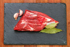 Raw meat with garlic. And bay leaf Stock Images