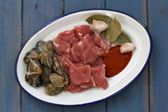 Raw meat with garlic and clams on dish Royalty Free Stock Images
