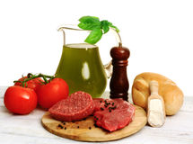 Raw meat with genuine ingredients Royalty Free Stock Images