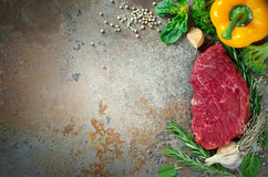Raw meat and greens. Raw meat herbs and vegetables, culinary background Stock Photos