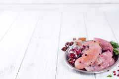 Raw meat for grill, BBQ or cooking with herbs and spices on an iron platter. In a white wooden table , top view Stock Photos