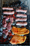 Raw meat on the grill Royalty Free Stock Photography