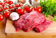 Raw meat with herbs and vegetables Royalty Free Stock Image