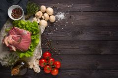 Raw meat with ingredients stock image