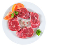 Raw meat. Isolated. Slices of fresh red meat on white plate Stock Photography