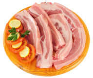 Raw meat. Isolated. Slices of raw meat with zucchini Royalty Free Stock Photography