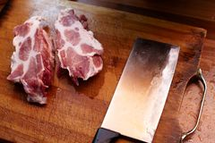 Raw meat and knife Stock Photography