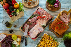 Raw meat and knifes. Mushrooms and green herbs. French cheese and chanterelles. Which taste you like more Royalty Free Stock Photos