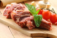 Raw meat, lamb chops. With vegetables Royalty Free Stock Photos