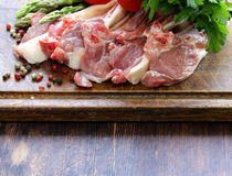 Raw meat, lamb chops with vegetables Royalty Free Stock Photos