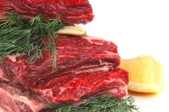 Raw meat and lemon Stock Photo