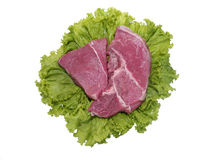 Raw Meat with Lettuce. White isolated image of uncooked cow meat and Lettuce stock photo