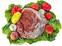 Raw meat on lettuce leaves. With garlic onion tomatoes and bell pepper Royalty Free Stock Photo