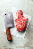 Raw meat and meat cleaver Royalty Free Stock Photo