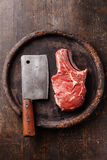 Raw meat and meat cleaver Royalty Free Stock Photography