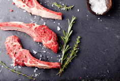 Raw meat, mutton, lamb rack with fresh herbs. Stock Image