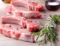 Raw meat, mutton, lamb rack on a wooden background Stock Photos